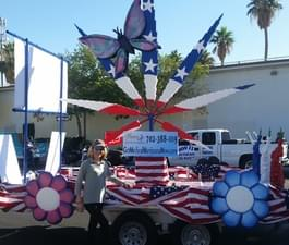 Our lovely founder Dee Powers in front of our Veterans Day Parade float!